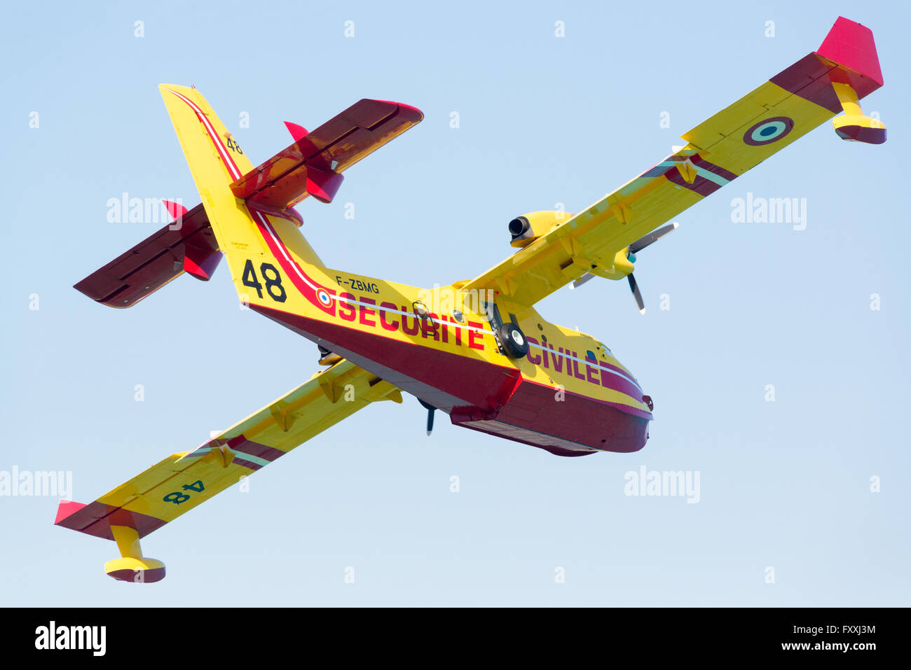 A CL-415 (Canadair Bombardier 415) of the French Sécurité Civile flying over Ile-Rousse, Mediterranean - Stock Image