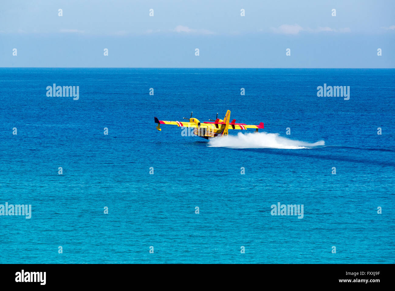 A CL-415 (Canadair Bombardier 415) of the French Sécurité Civile collecting water. Mediterranean Sea, - Stock Image