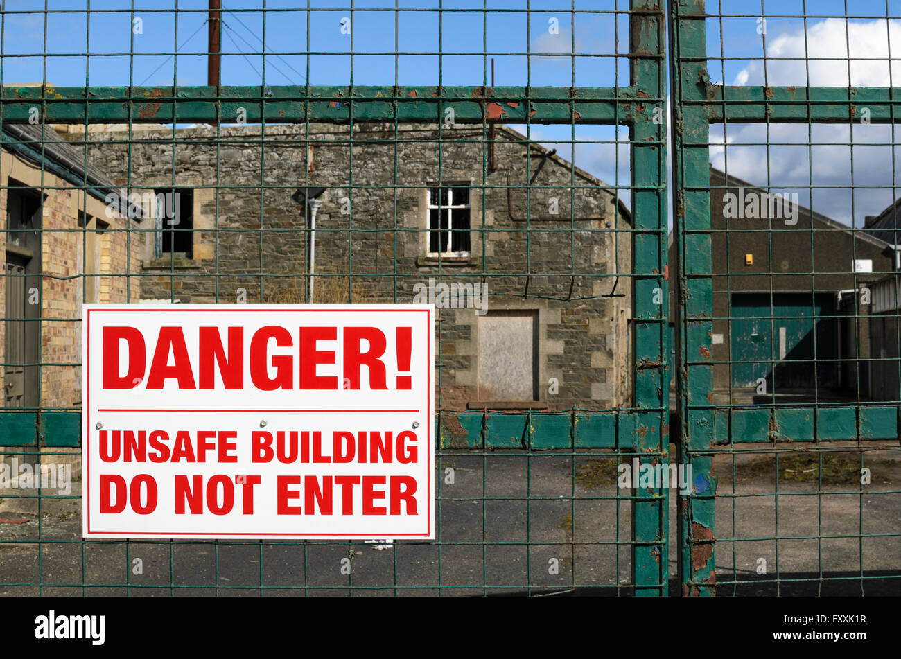 danger do not enter sign outside some empty textile buildings in the
