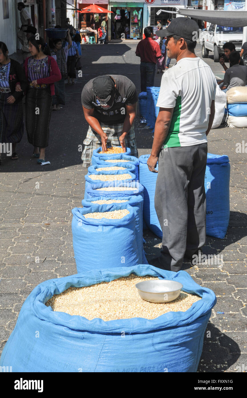 Two person with bags of corn at Santiago de Atitlan on Guatemala, 11 February 2014 - Stock Image