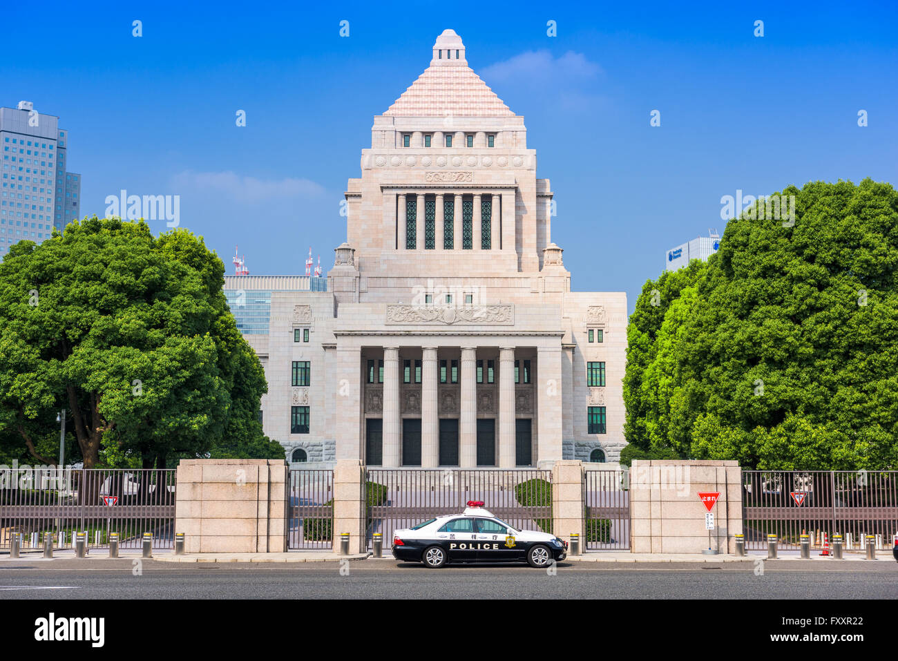 TOKYO, JAPAN - JULY 31 2015: A police crusier below The National Diet Building of Japan. Stock Photo