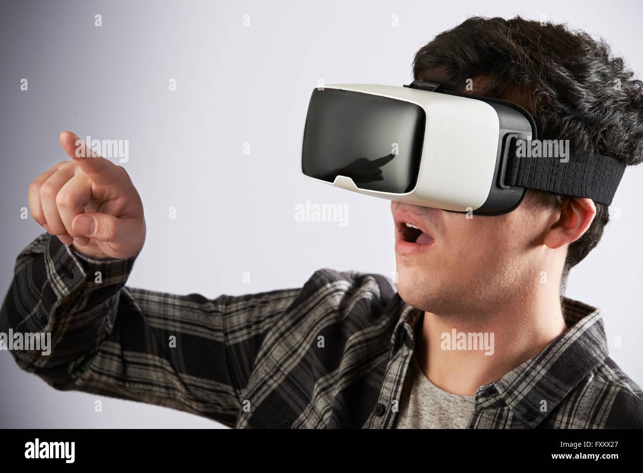 Young Man Wearing Virtual Reality Headset - Stock Image