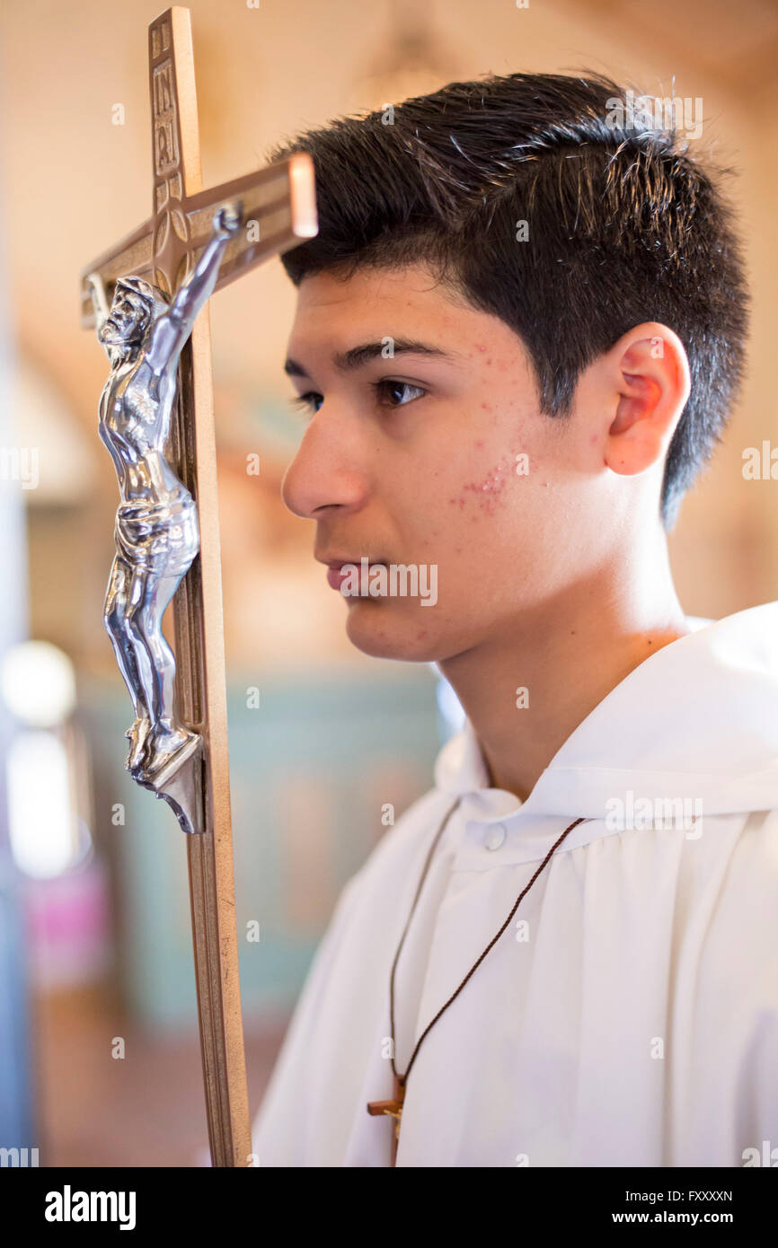 Detroit, Michigan - An altar server waits for mass to begin at Most Holy Redeemer Catholic Church. - Stock Image