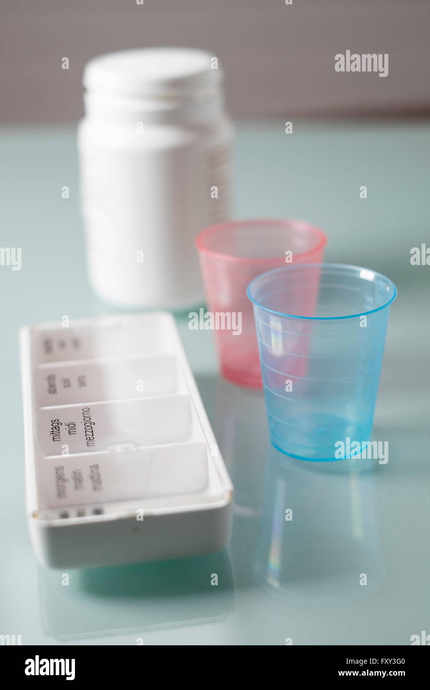 Safety container, cups and daily dose dish - Stock Image