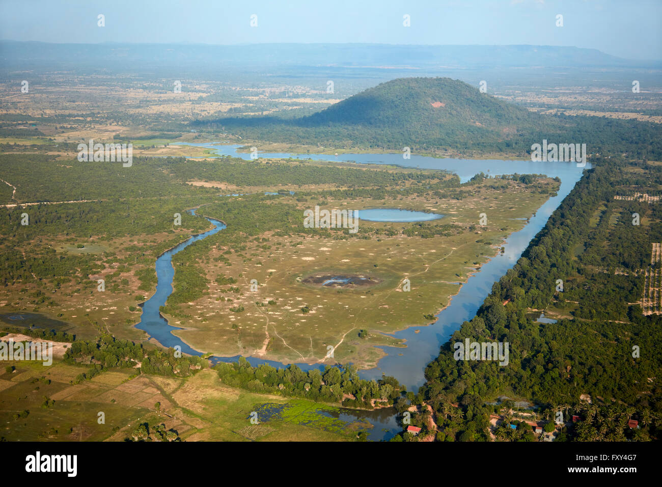 Ankorian Reservoir and Phnom Bok Hill, Angkor Archaeological Park, near Siem Reap, Cambodia - aerial - Stock Image