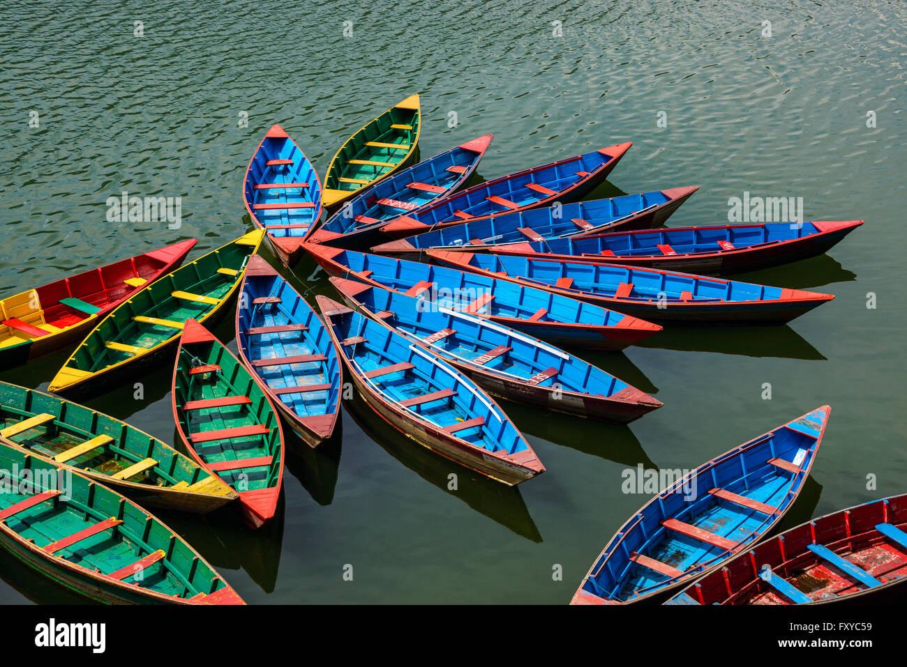 Colorful small boats on Phewa Lake in Pokhara, Nepal - Stock Image
