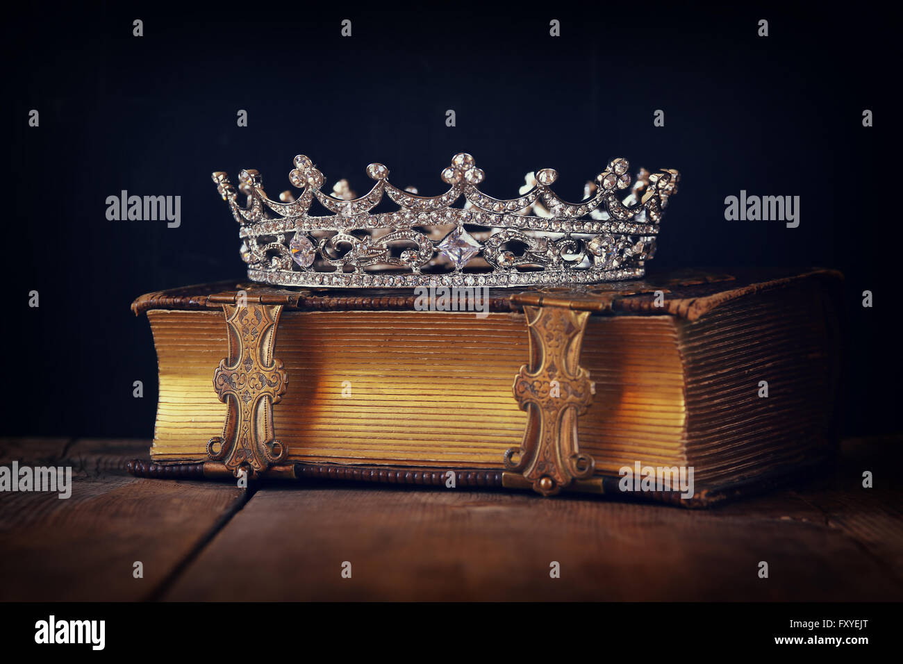 decorative crown on old book. vintage filtered. selective focus. - Stock  Image f0ab4ac2369c