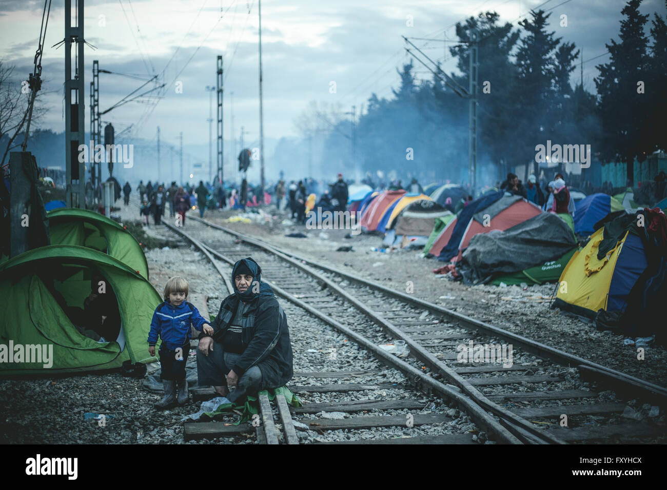 Camp with refugees on the train tracks, refugee camp in Idomeni, border with Macedonia, Greece - Stock Image