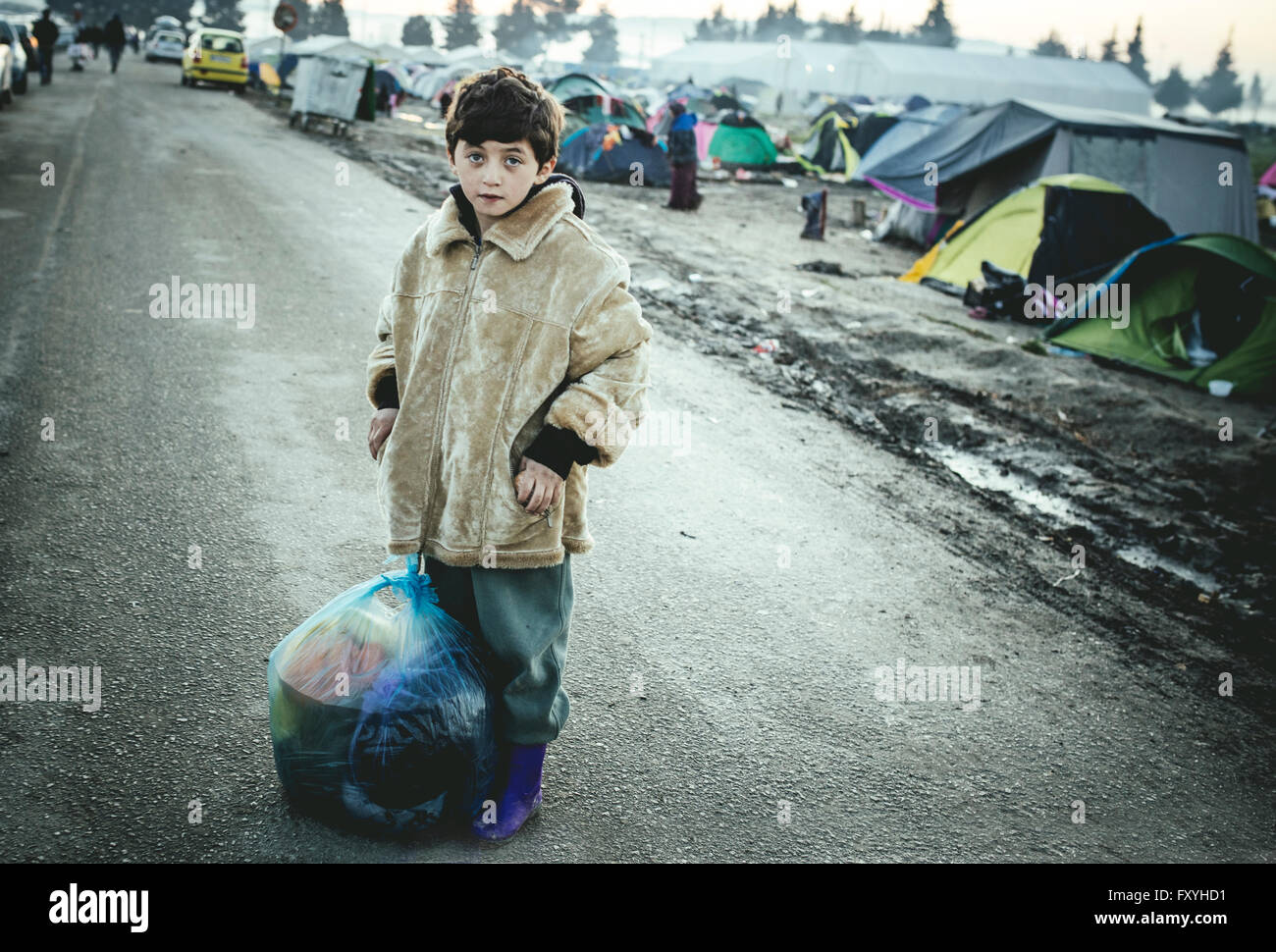 Afghan boy, child refugee, refugee camp in Idomeni, border with Macedonia, Greece - Stock Image