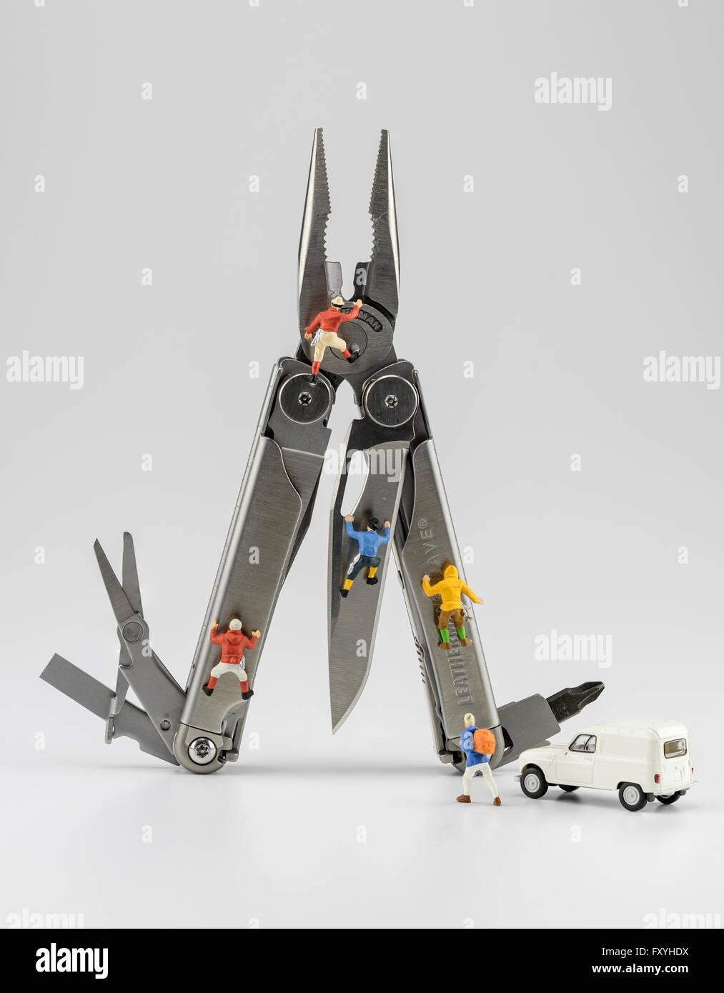 Leatherman tool, multitool with mountaineer figures - Stock Image