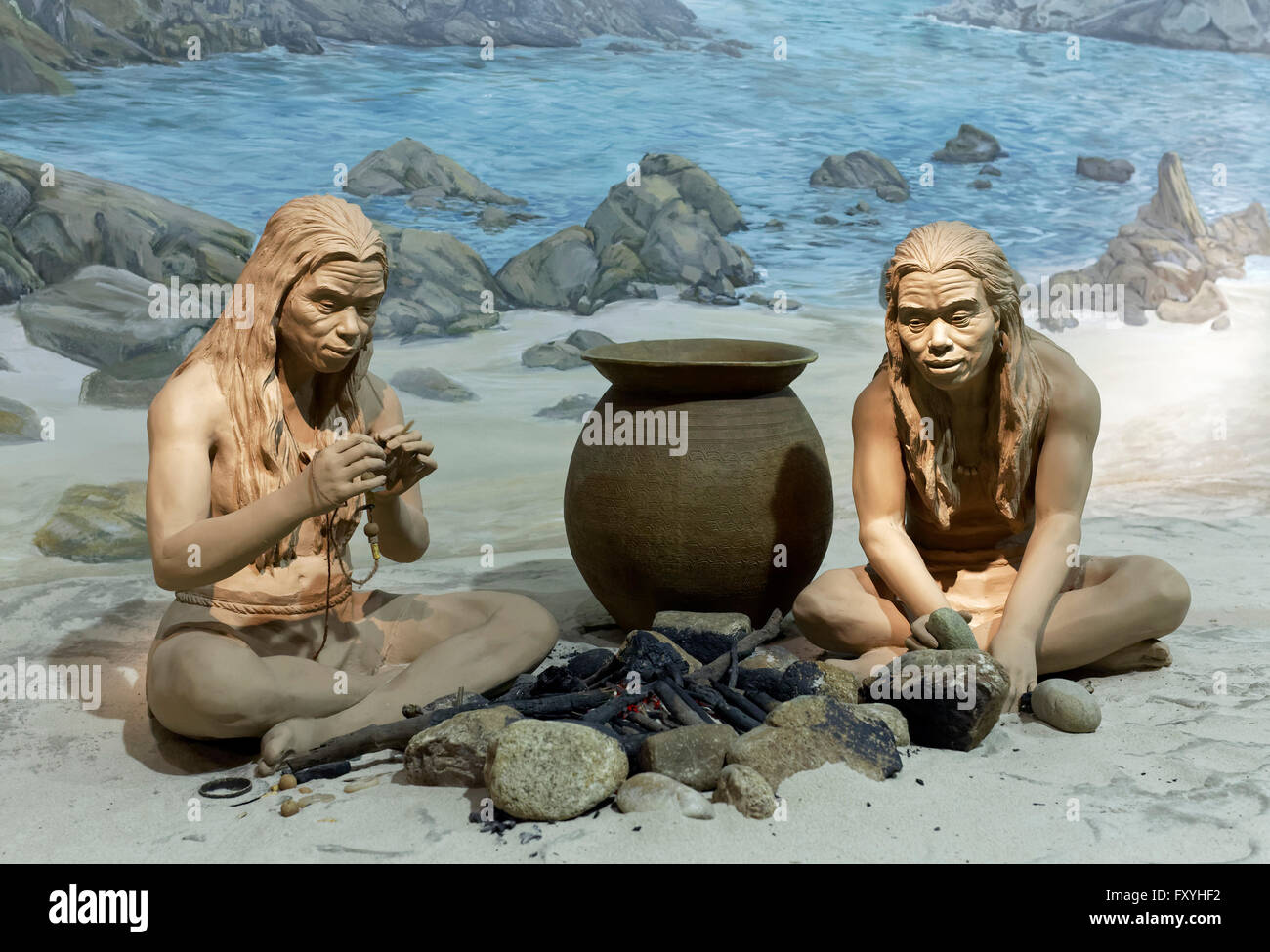 Indigenous people at a fire place on the coast, depiction with figures, Diorama in the Hong Kong Museum of History - Stock Image