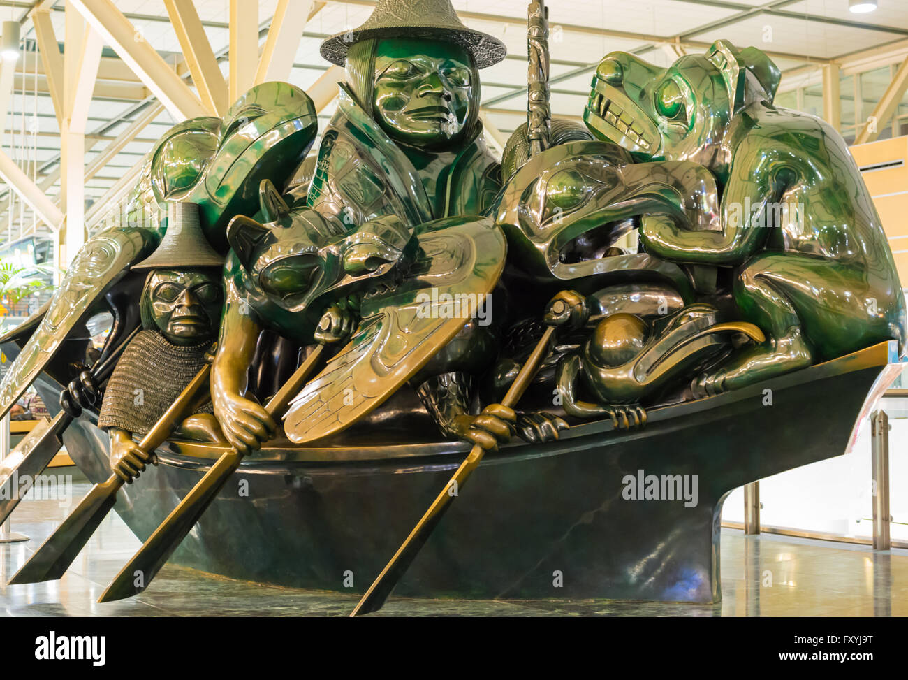 The Jade Canoe version of the Spirit of Haida Gwaii, by Bill Reid, located in the Vancouver International Airport. - Stock Image