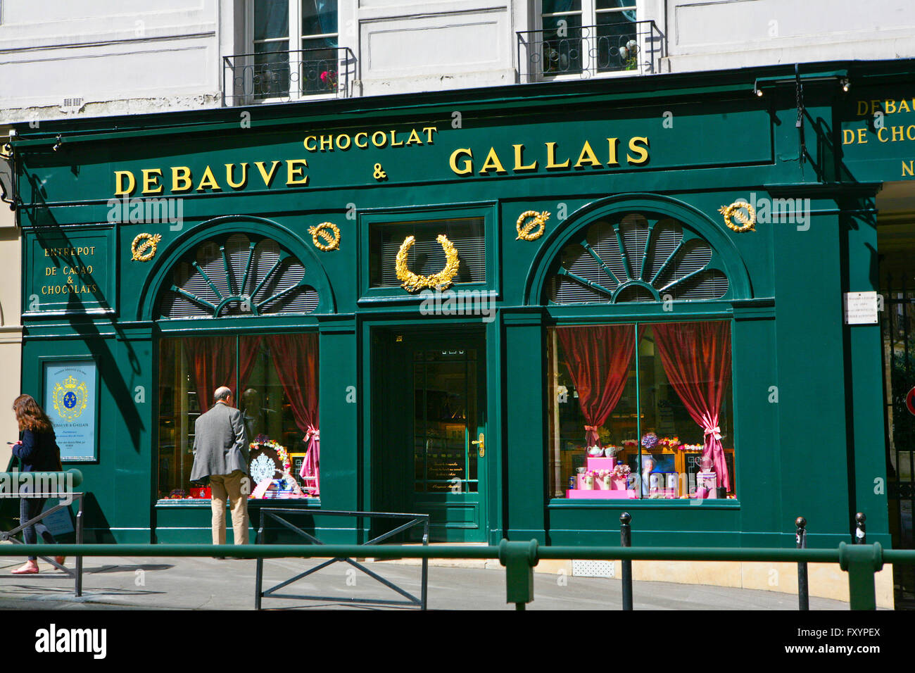 Man looking at the window of the famous Debauve&Gallais chocolate store.Since 1779 ,street des saint Peres,Paris, - Stock Image