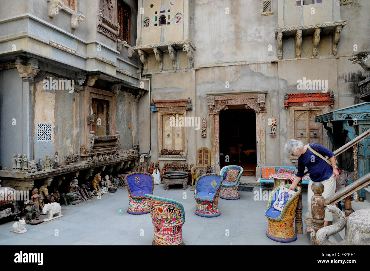 A customer browses in the courtyard of a vast textile, furniture and objet d'art store in the northern Indian - Stock Image
