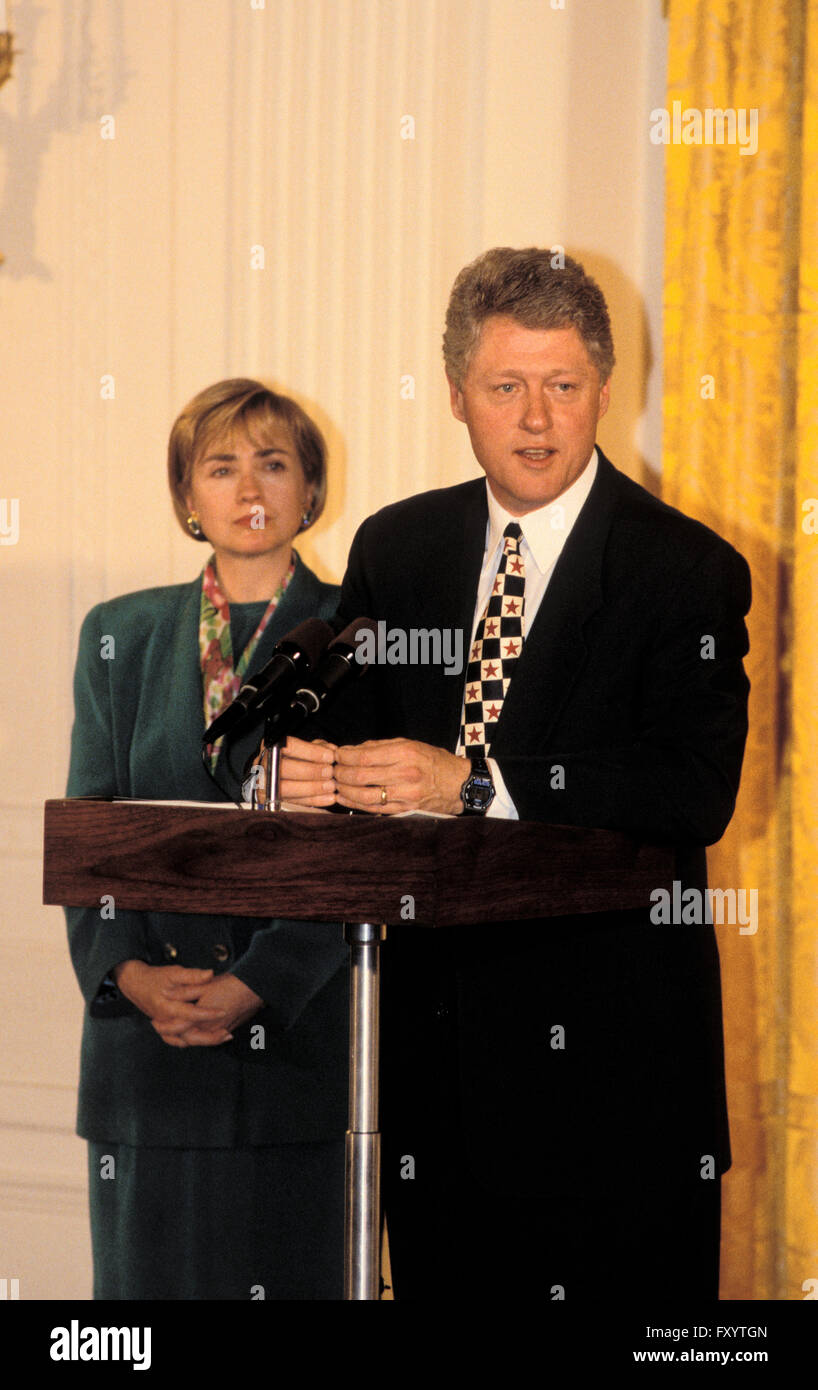 President Clinton gives a speech in the East Room, at the White House with Hillary by his side 1997 - Stock Image