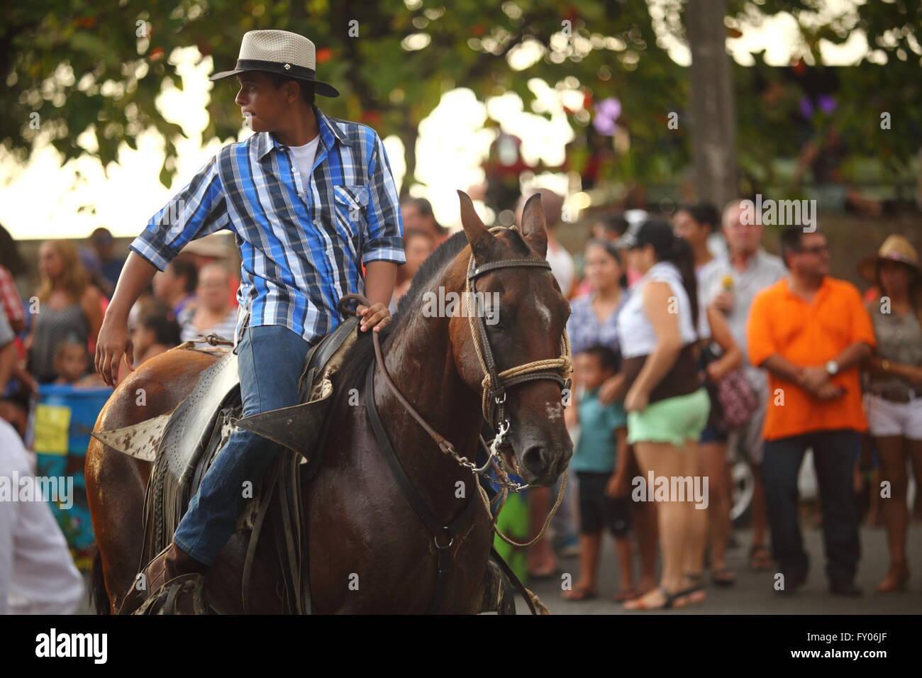Teen boy riding horse in parade - Stock Image