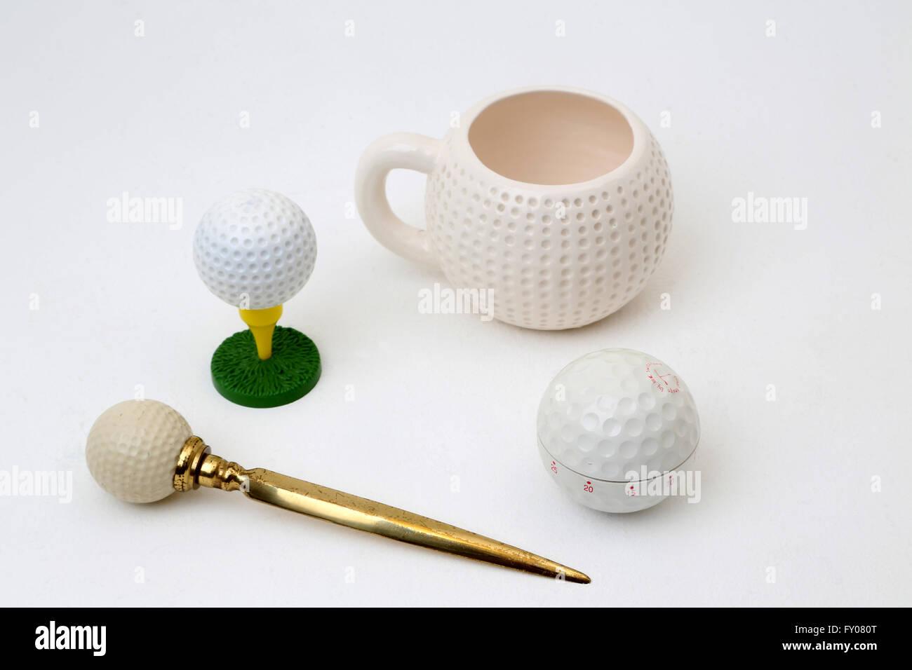 Golf Paraphernalia - Mug, Aftershave, Letter Opener And Cooking Timer - Stock Image