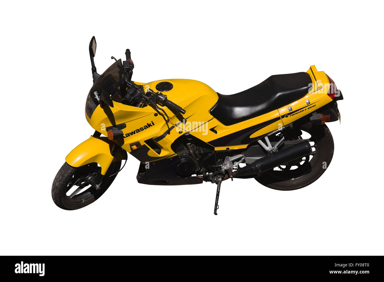 Cut Out. Yellow Kawasaki Ninja ZZ-R-250 Twin Cam 8 Valve motorcycle parked without rider isolated on white background. - Stock Image