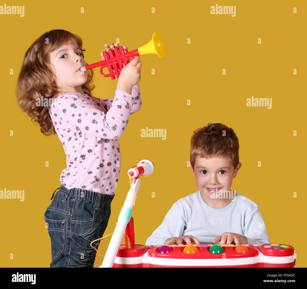 boy and little girl play music - Stock Image