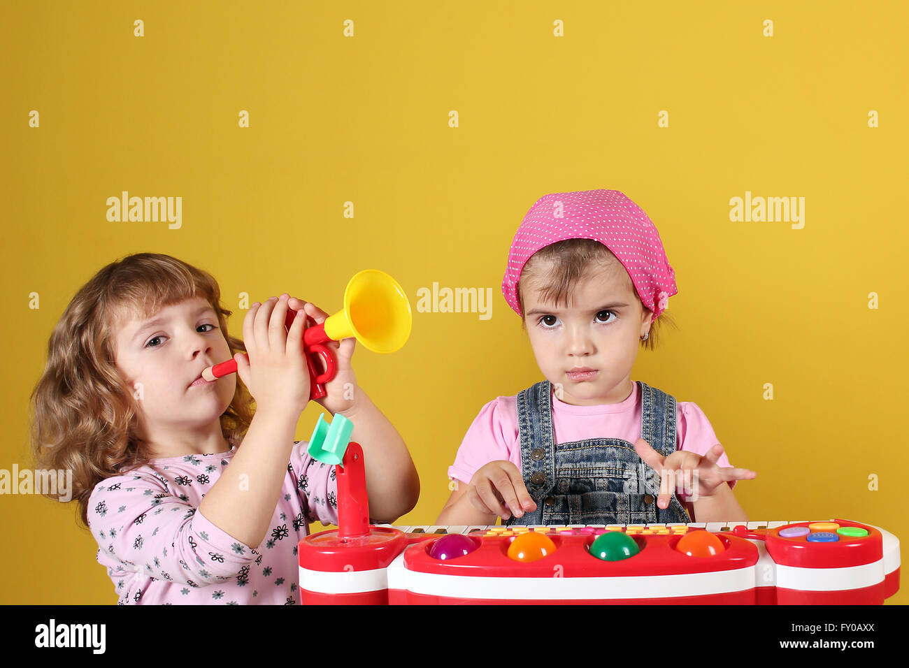 two little girls playing music - Stock Image