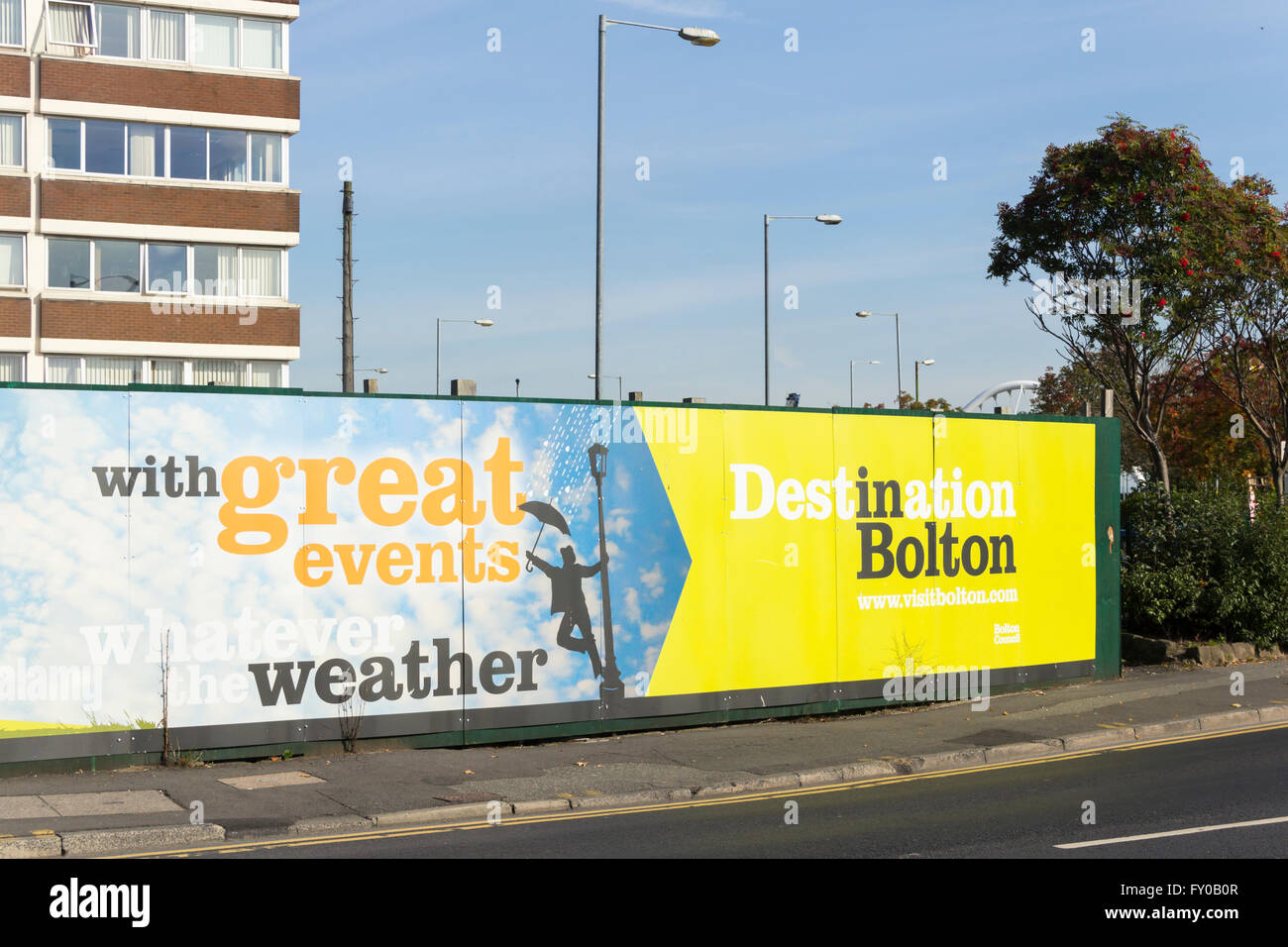 Former site of Odeon cinema in Bolton town centre, surrounded by hoarding promoting the town to visitors. - Stock Image