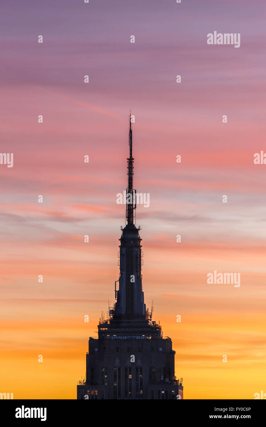 Empire State Building Spire at Sunset. Aerial view of the Midtown Manhattan skyscraper, New York City - Stock Image