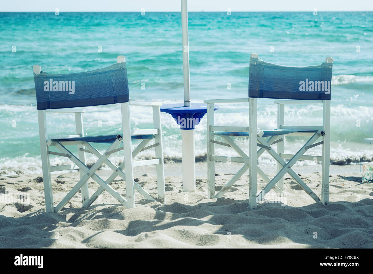 beach chairs on the shore - Stock Image