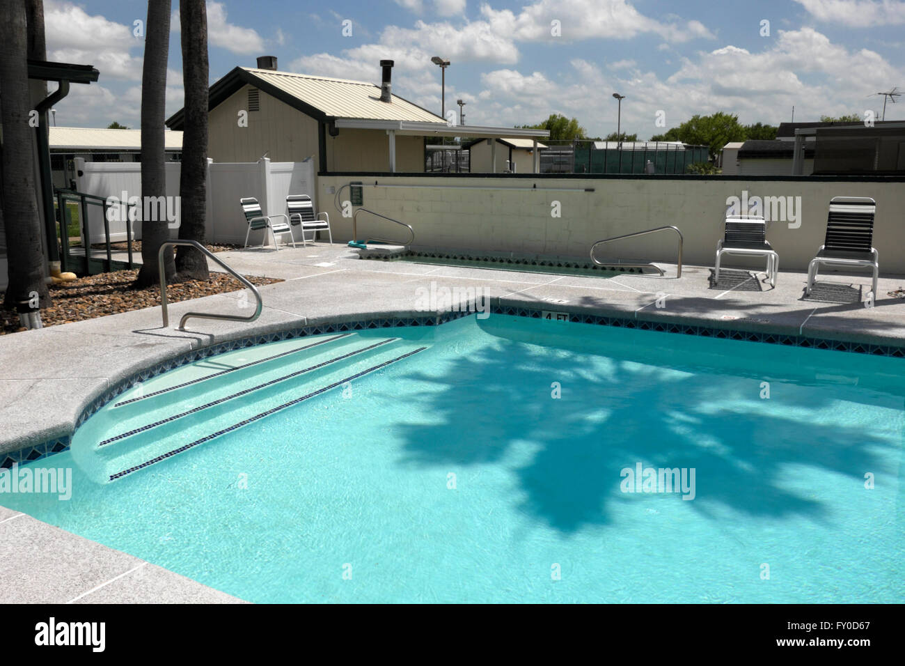 Swimming pool filled with clear aqua blue water at a senior citizens RV resort in south Texas, USA. - Stock Image