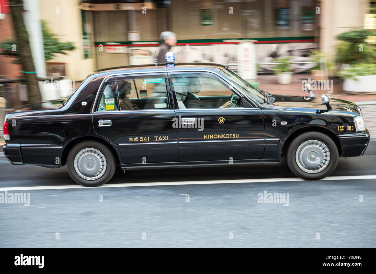 Toyota Crown taxi on street in Tokyo city, Japan - Stock Image