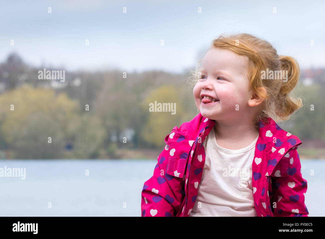 cute toddler sticking tongue out - Stock Image