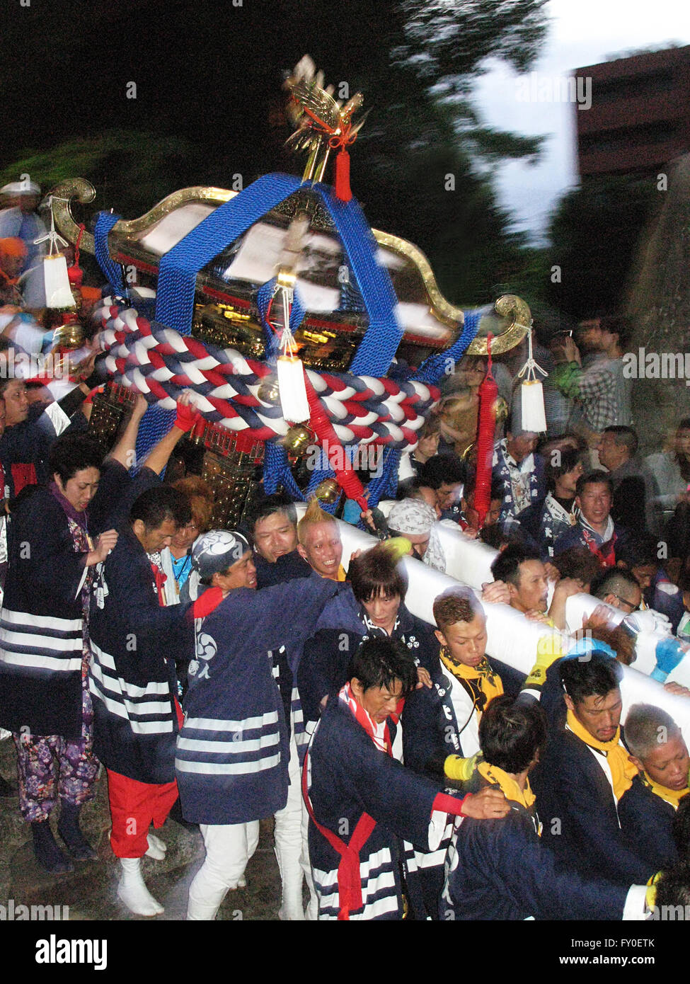 festival participants carry Mikoshi down stairway Matsuyama Japan - Stock Image