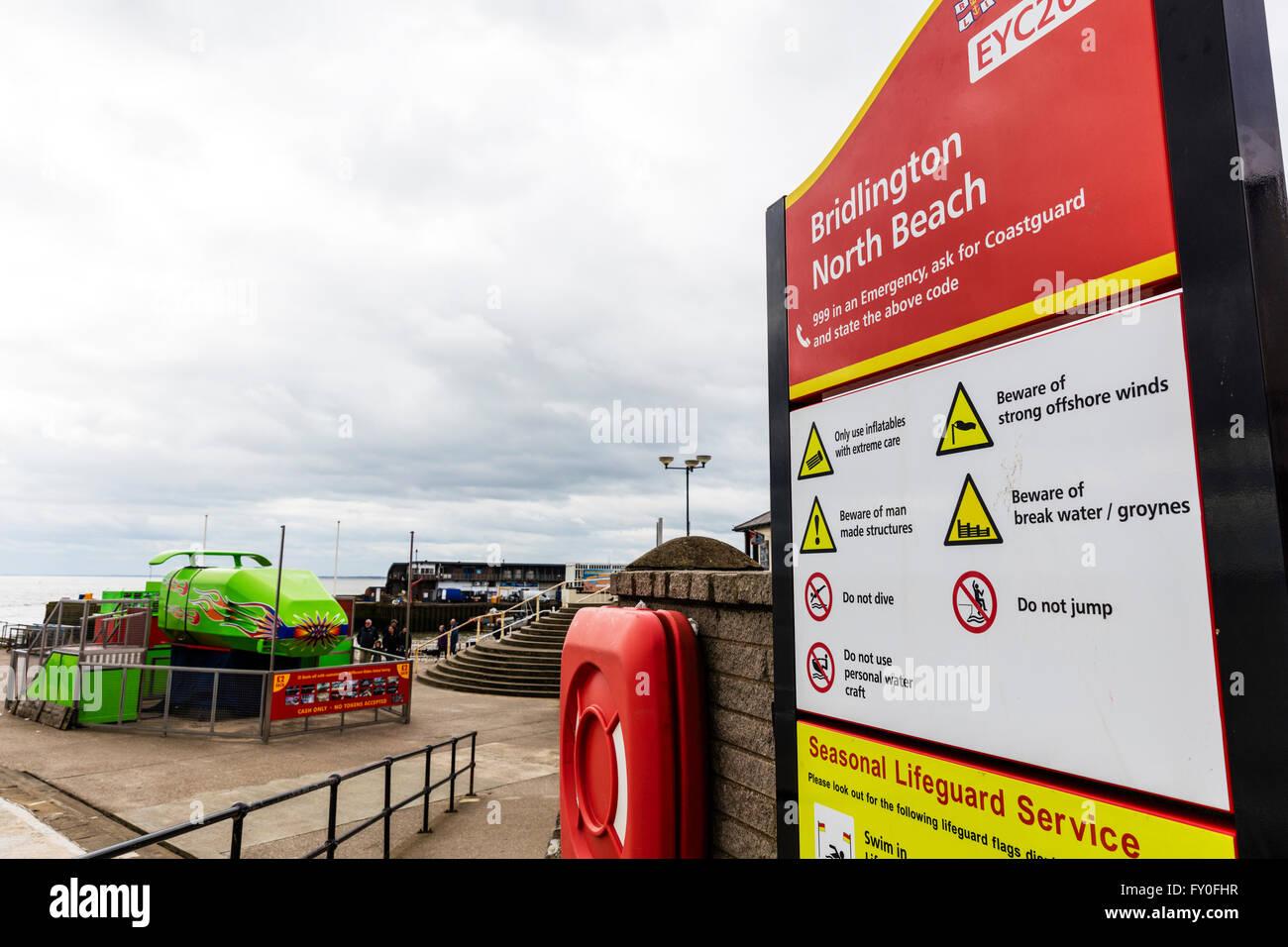 Bridlington north beach sign warnings life ring Yorkshire UK England coastal town towns - Stock Image