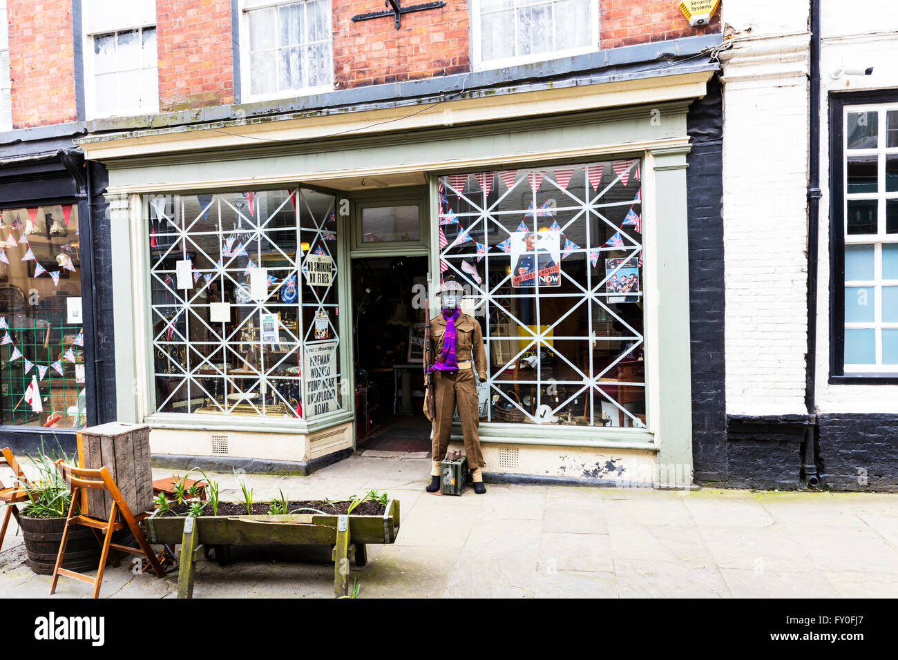 Bridlington old town shops shop dads army decor blitz tape on windows Yorkshire UK England coastal town towns - Stock Image