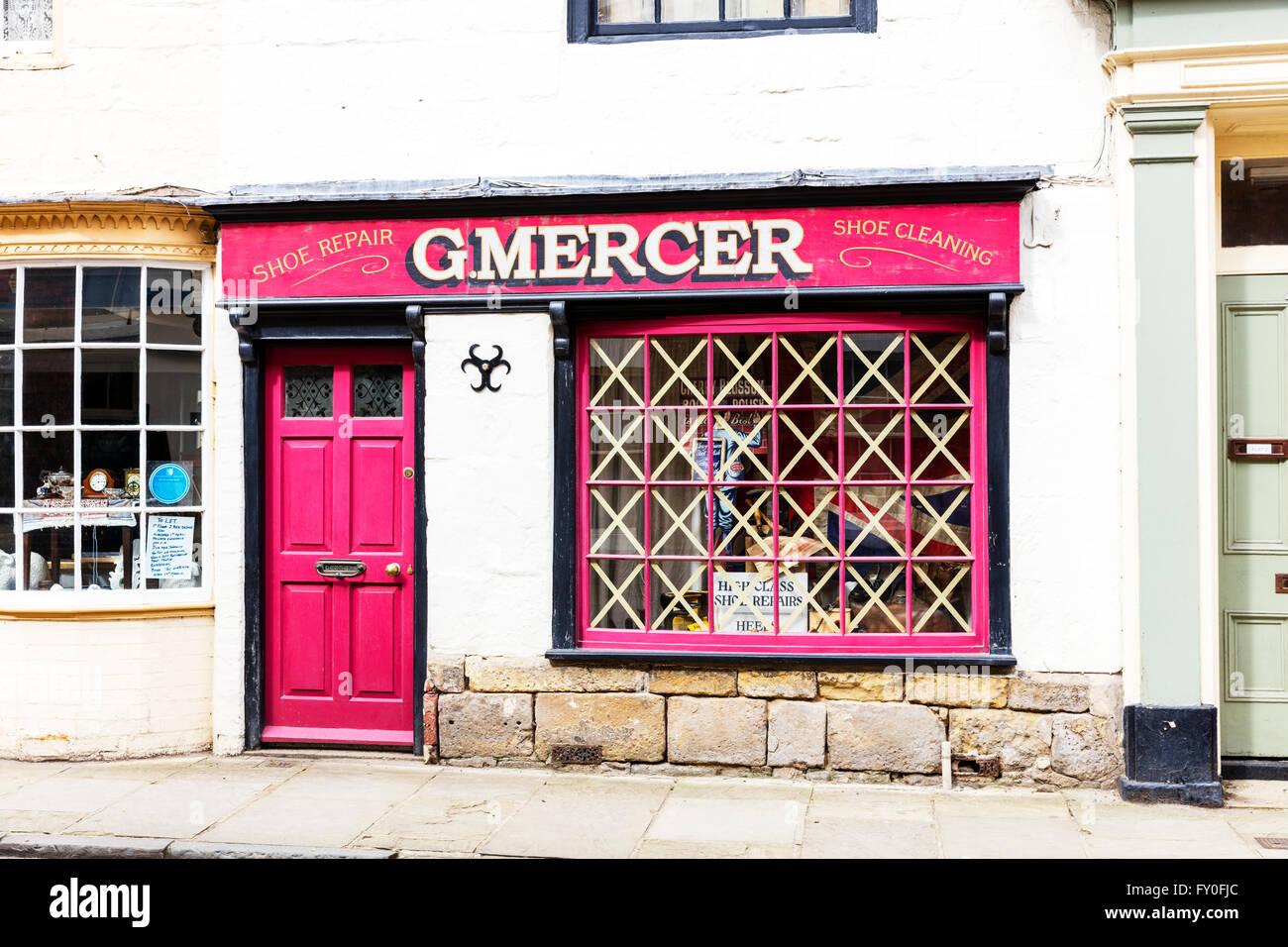 Bridlington old town shops shop dads army decor blitz tape on windows Yorkshire UK England coastal town towns - Stock Image