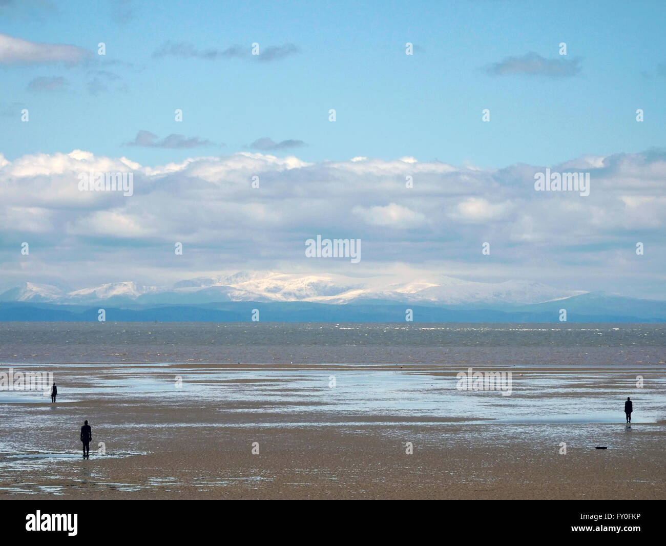 View of snow capped Welsh Hills from Crosby Beach. Sefton. Merseyside UK - Stock Image
