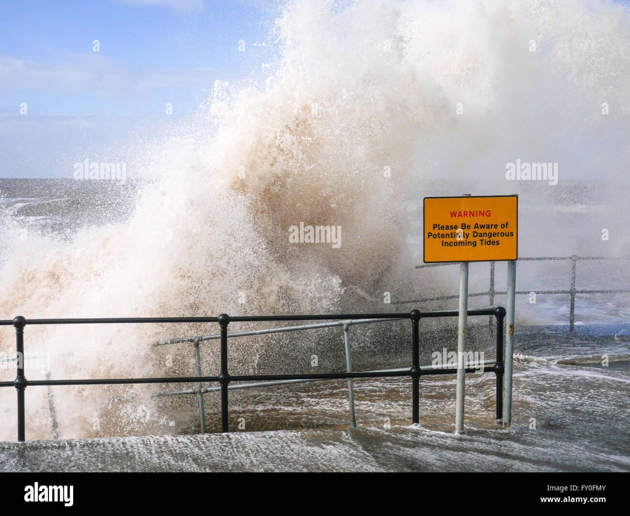 UK Weather. Crosby. Merseyside UK. 7th April 2016. A windy  day during high tide at Crosby Beach makes for some - Stock Image