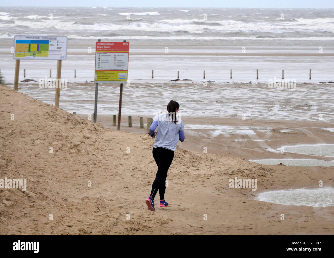 UK Weather Cold changeable  Spring day Ainsdale Beach Merseyside.6 April 2016. Cold, windy changeable  conditions - Stock Image