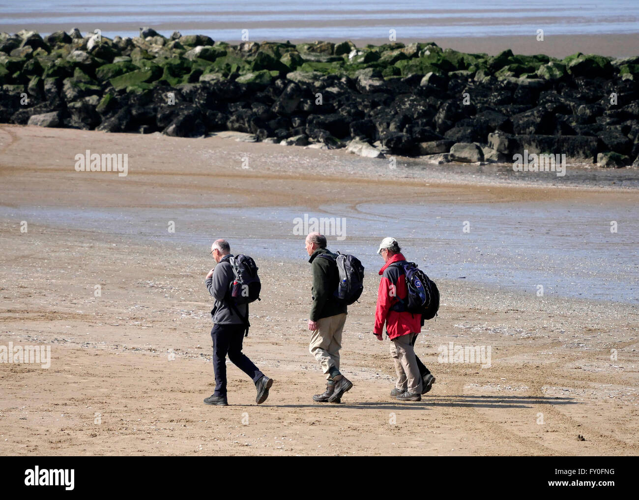Weather Sunny Day in New Brighton  Merseyside. UK 3 April 2016. Bright sunny day. People enjoy a walk on the beach.© - Stock Image