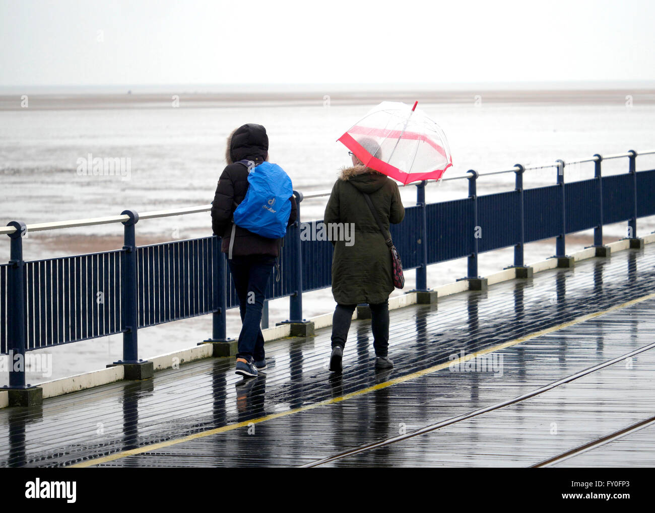 Weather Southport Merseyside UK. 2 April 2016. People out and about on a rainy Saturday in Southport Merseyside - Stock Image