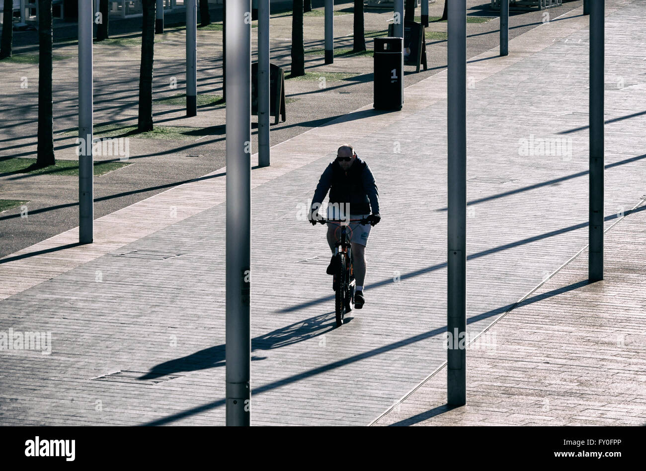 A cyclist enjoying a ride in Liverpool late afternoon. - Stock Image