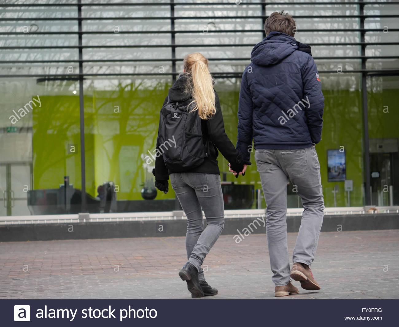 A couple taking a walk in Greenwich.London UKA couple taking a walk in London UK - Stock Image