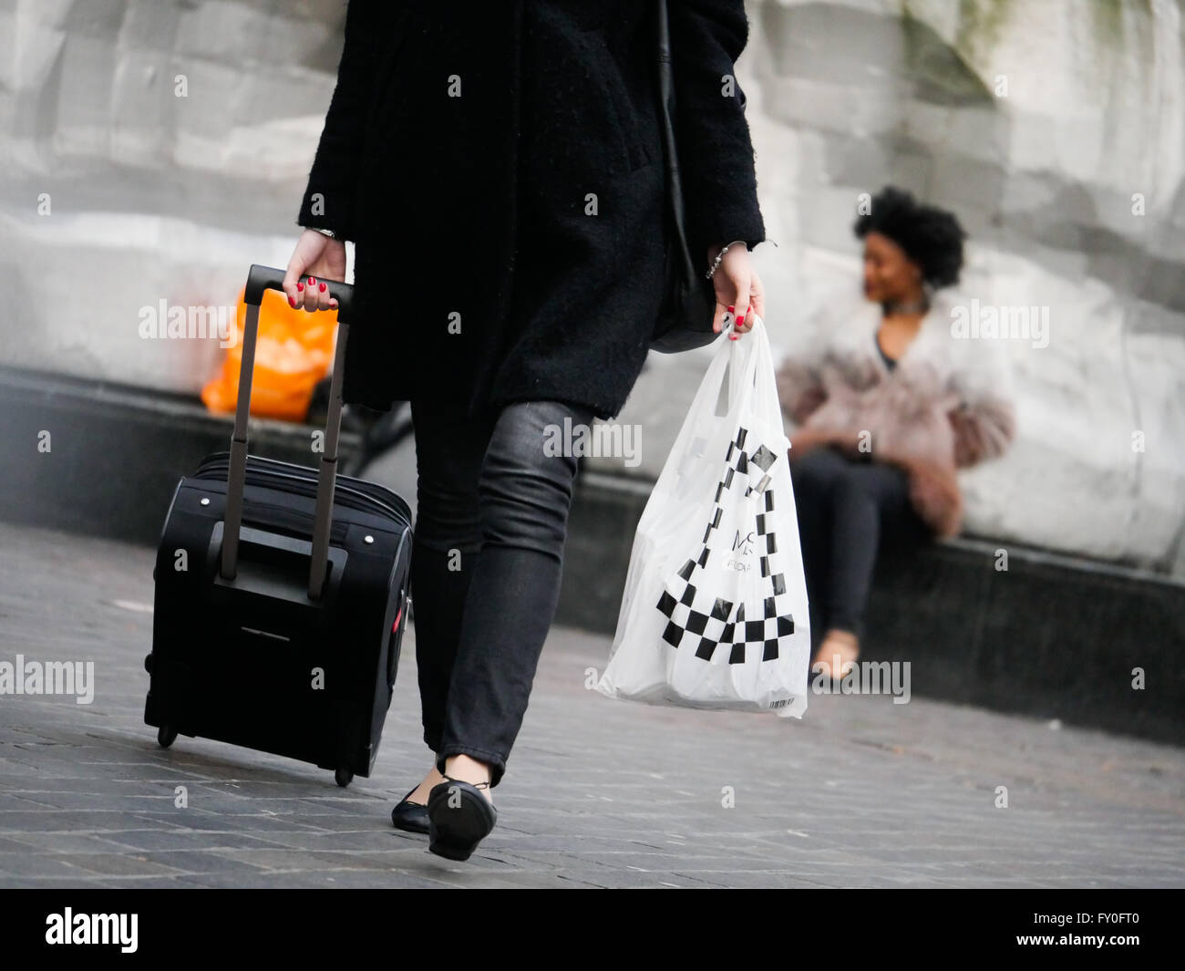 Person with luggage - Stock Image