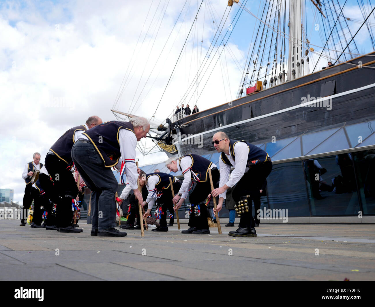 Morris dancers entertain the crowd in Greenwich London - Stock Image