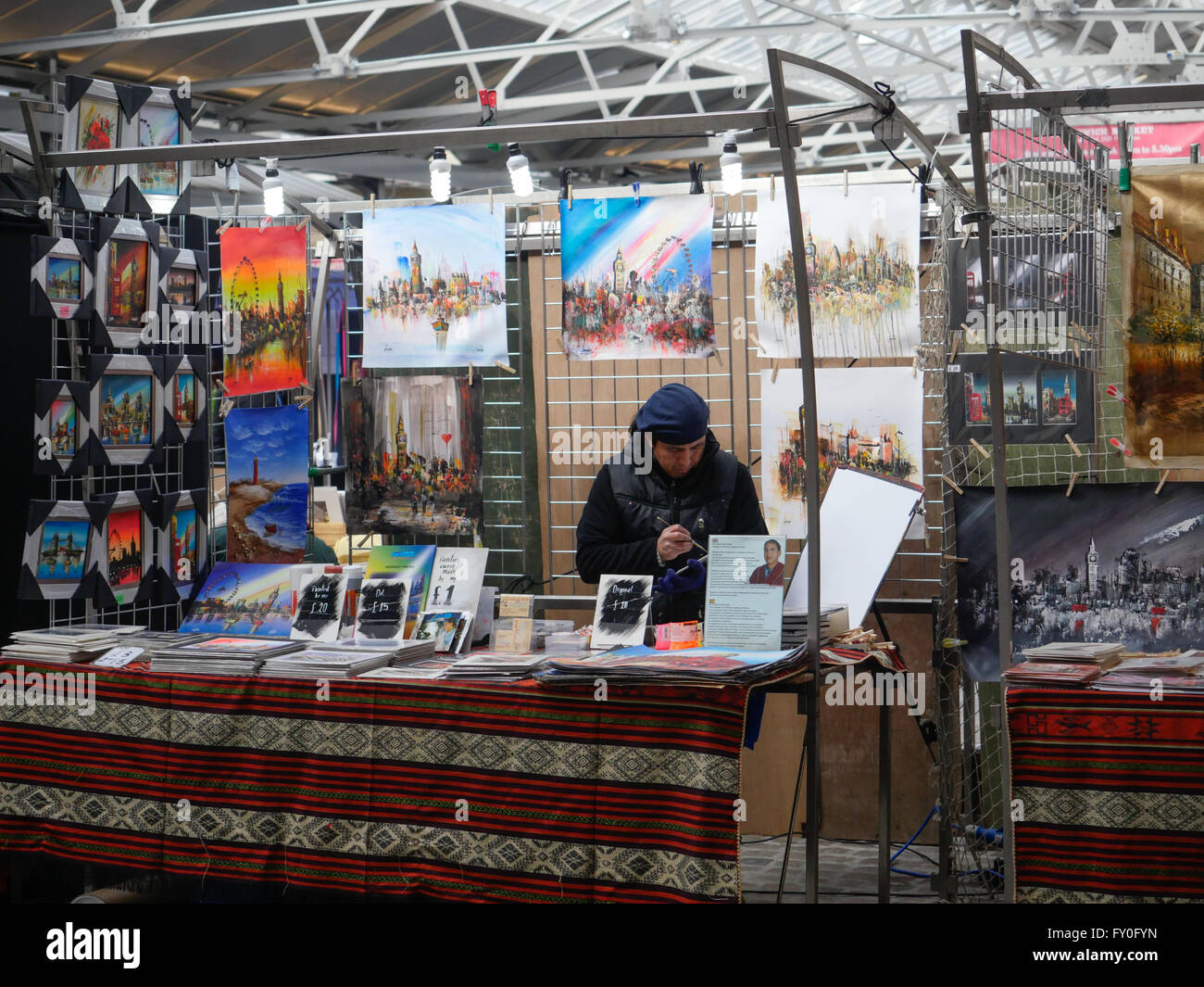 An artists stall in Greenwich Market London UK - Stock Image