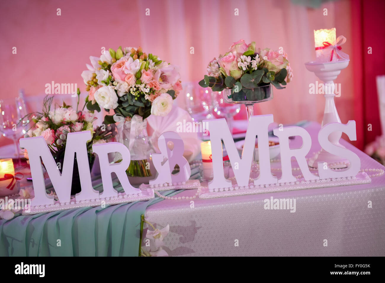 Beautiful wedding table with Mr. & Mrs. in natural light Stock Photo ...