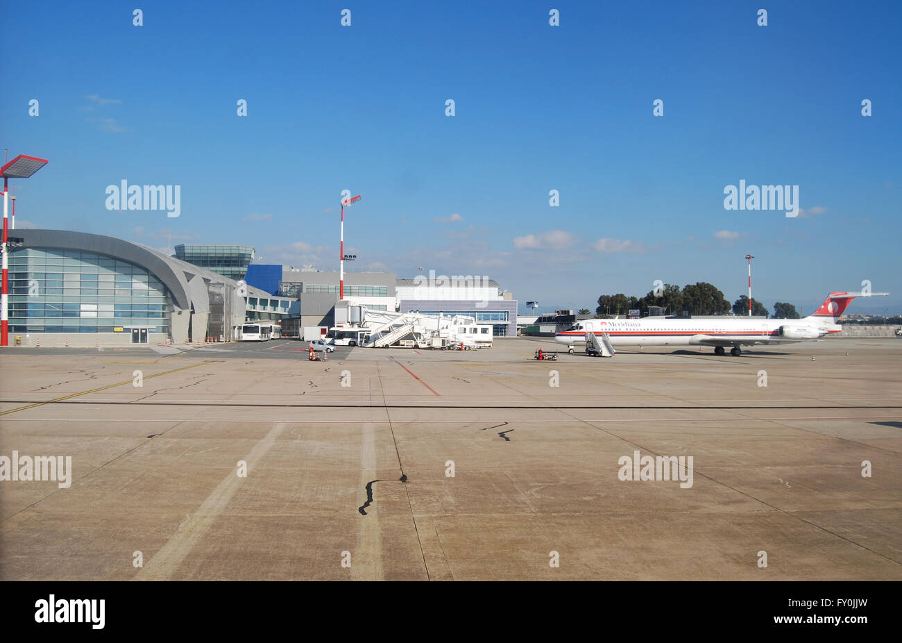 Cagliari, Italy - January 24, 2010: Meridiana Airplane in the airport at Cagliari. Land and daytime as editorial - Stock Image