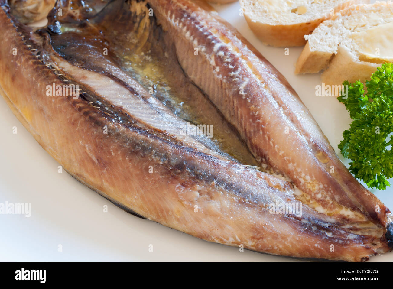 Manx Kippers or skeddan jiarg naturally smoked herrings produced in the Isle of Man - Stock Image
