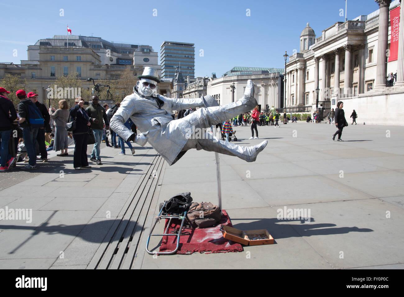 Levitating street entertainer in Trafalgar Square, central London, UK - Stock Image