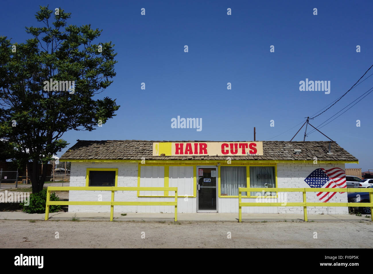 exterior of Hispanic hair salon in small town near Bakersfield Southern California USA - Stock Image