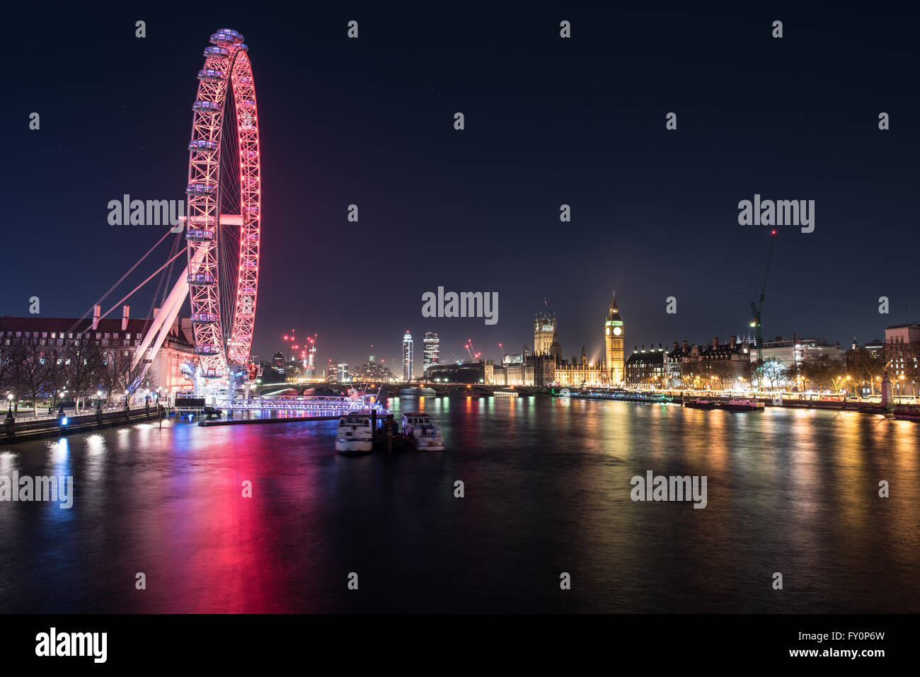 Looking south along the River Thames towards the London Eye and Houses of Parliament, London, England, United Kingdom - Stock Image
